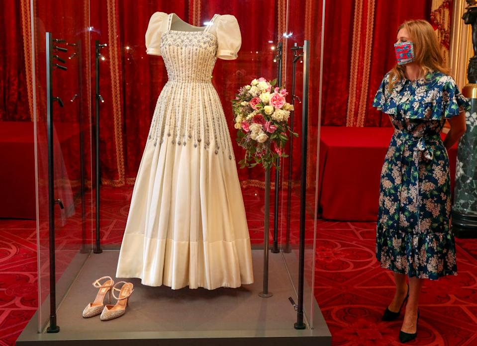 Princess Beatrice admires her vintage wedding dress, now on display at Windsor Castle. (Getty Images)