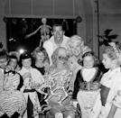 """<p>If you picked up a copy of the <a href=""""http://www.grayflannelsuit.net/blog/sears-catalog-goodness-2-fall-1958-halloween-costumes"""" rel=""""nofollow noopener"""" target=""""_blank"""" data-ylk=""""slk:Sears catalogue in the fall of 1958"""" class=""""link rapid-noclick-resp"""">Sears catalogue in the fall of 1958</a>, you'd see that kids could choose from an array of costumes including a a gypsy, a Colonial girl, a robot, a bride, and a fairy princess, as well as characters from TV shows, like Lassie, Popeye, Bugs Bunny, and Zorro. Pictured here, actress Jayne Mansfield and her husband, Mickey Hargitay, celebrate daughter Jayne Marie's birthday with a Halloween fête in 1958.</p>"""
