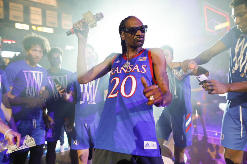 In this Friday, Oct. 4, 2019 photo, rapper Snoop Dogg performs for the Allen Fieldhouse crowd during Late Night in the Phog, Kansas' annual NCAA college basketball kickoff at Allen Fieldhouse in Lawrence, Kan. (Nick Krug/The Lawrence Journal-World via AP)
