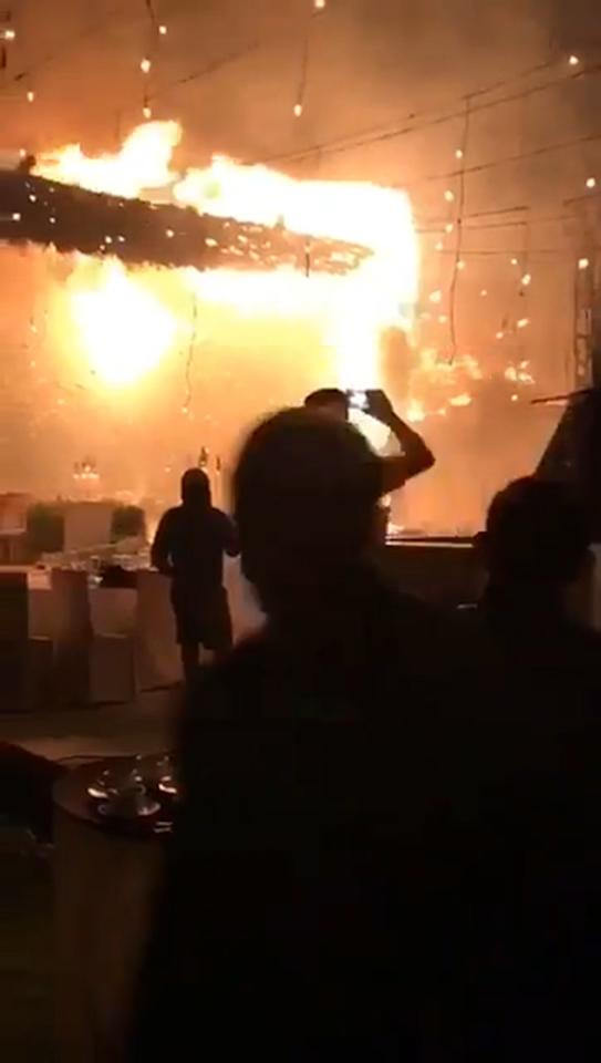 Watch as wedding goes up in flames after fireworks set off blaze that burns down reception venue