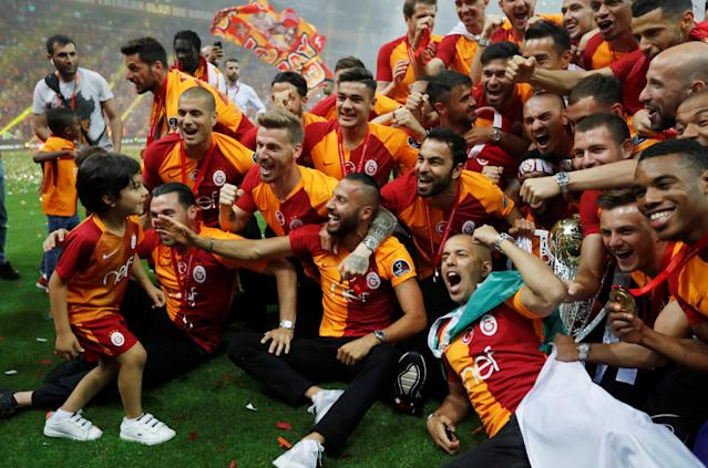 Soccer Football - Galatasaray Turkish Super League Trophy Presentation - Turk Telekom Arena, Istanbul, Turkey - May 20, 2018 Galatasaray players celebrate with the trophy REUTERS/Murad Sezer