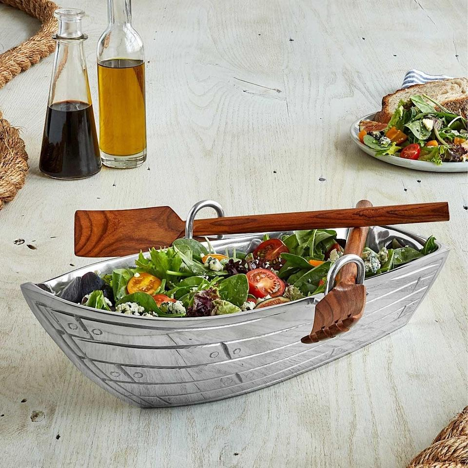 <p>Who wouldn't want to be served from this <span>Row Boat Serving Bowl With Wood Serving Utensils</span> ($65)?</p>