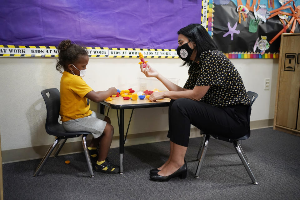 Teacher Juliana Urtubey, right, interacts with Kamari Wolfe in a class at Kermit R Booker Sr Elementary School Wednesday, May 5, 2021, in Las Vegas. Urtubey is the the 2021 National Teacher of the Year. (AP Photo/John Locher)