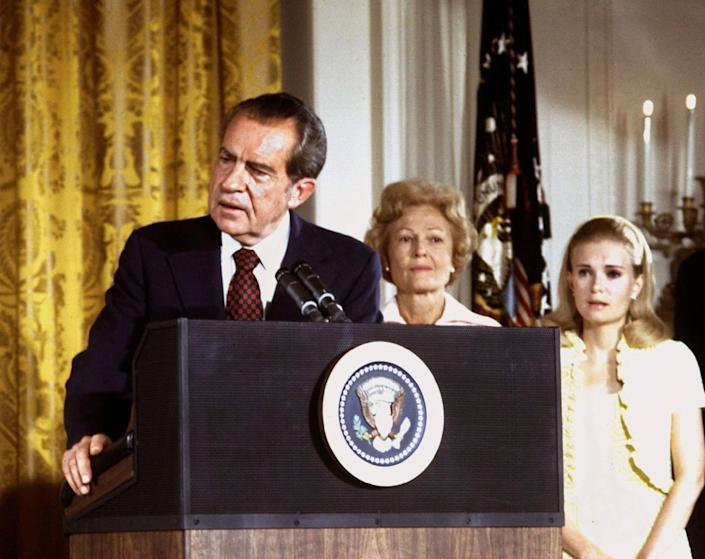 """<p>President Nixon, with first lady Pat Nixon and daughter Tricia Nixon, says goodbye to family and staff in the White House East Room on August 9, 1974. Nixon resigned his office, or """"resigned in disgrace"""" as many of the news accounts would say, as it became clear the House of Representatives would impeach him for Watergate misdeeds and the Senate would follow by convicting him. (Photo: Stringer/Reuters) </p>"""