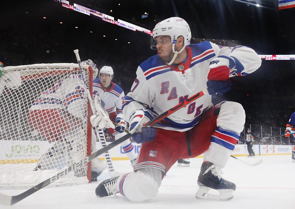 NEW YORK, NEW YORK - FEBRUARY 25: Tony DeAngelo #77 of the New York Rangers skates against the New York Islanders at NYCB Live's Nassau Coliseum on February 25, 2020 in Uniondale, New York. The Rangers defeated the Islanders 4-3 in overtime. (Photo by Bruce Bennett/Getty Images)