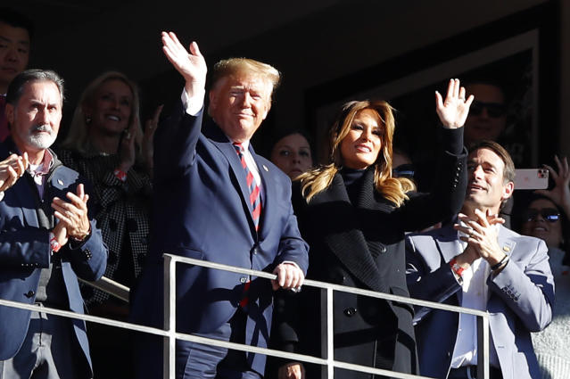 President Trump, seen here at last year's Alabama-LSU game, and Michael Bloomberg (not pictured) will be making a huge campaign ad push in the Super Bowl. (Kevin C. Cox/Getty Images)
