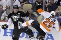 Pittsburgh Penguins' Jordan Staal (11) collides with Philadelphia Flyers' Matt Carle (25) during the third period of Game 2 of an opening-round NHL hockey playoff series in Pittsburgh, Friday, April 13, 2012. The Flyers won 8-5. (AP Photo/Gene J. Puskar)