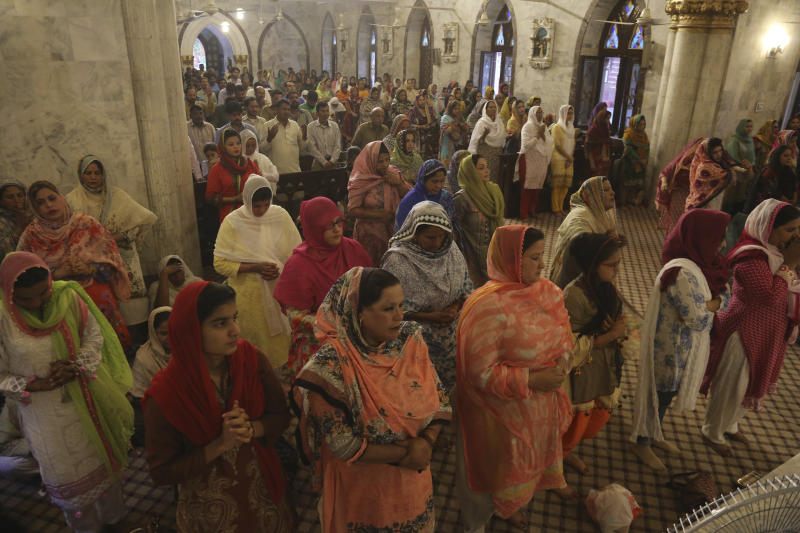 Pakistani Christians attend special prayers for the victims of bomb explosions in churches and hotels in Sri Lanka, in Lahore, Pakistan, Tuesday April 23, 2019. The death toll from the Easter Sunday bombings in Sri Lanka, rose Tuesday to more than 300. (AP Photo/K.M. Chaudary)