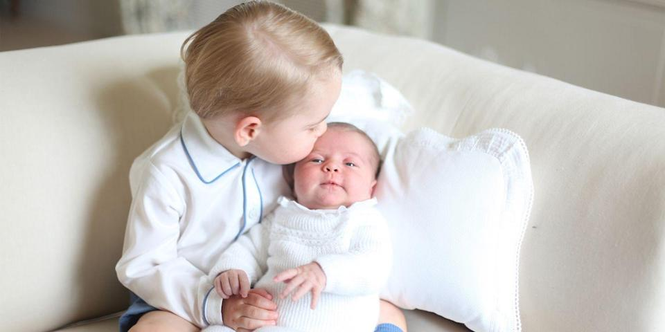 <p>Prince George gives his baby sister a sweet kiss.</p>