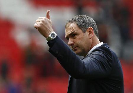 Swansea City manager Paul Clement acknowledges fans after the match