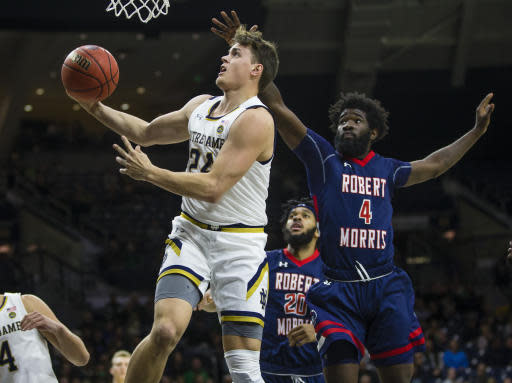 Notre Dame's Robby Carmody (24) drives to the basket past Robert Morris' Jalen Hawkins (4) during an NCAA college basketball game Saturday, Nov. 9, 2019 at Purcell Pavilion in South Bend, Ind. (Michael Caterina/South Bend Tribune via AP)
