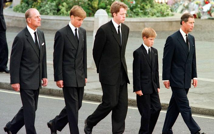 Prince Philip, Prince William, Earl Spencer, Prince Harry and Prince Charles walk behind Diana's coffin - JEFF J MITCHELL/AFP