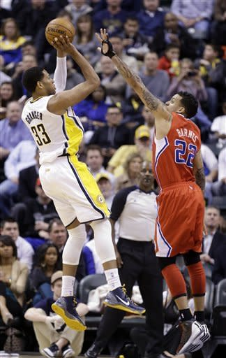 Indiana Pacers forward Danny Grange shoots over Los Angeles Clippers forward Matt Barnes during the first half of an NBA basketball game in Indianapolis, Thursday, Feb. 28, 2013. (AP Photo/Michael Conroy)