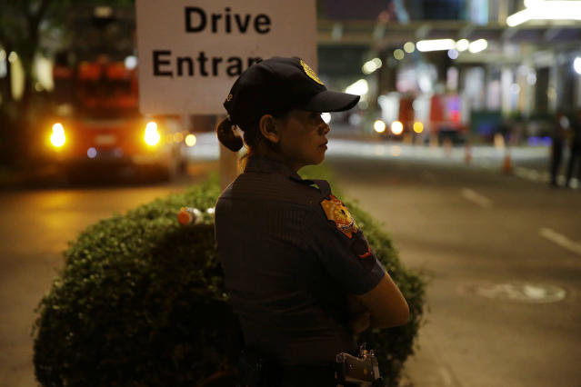 <p>Police outside a hotel at the Resorts World Manila complex, early Friday, June 2, 2017, in Manila, Philippines. (Photo: Aaron Favila/AP) </p>