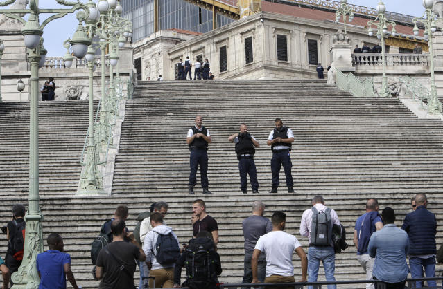 <p>French police officers block access on the stairs leading to Marseille 's main train station, Oct. 1, 2017 in Marseille, southern France. French police warn people to avoid Marseille's main train station amid reports of knife attack, assailant shot dead. (AP Photo/Claude Paris) </p>