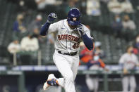 Houston Astros' Alexander De Goti runs to first on a two-run single during the fifth inning of the team's baseball game against the Seattle Mariners Friday, April 16, 2021, in Seattle. (AP Photo/Jason Redmond)