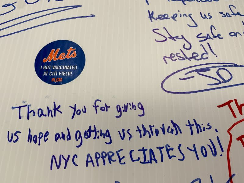 A note of gratitude is written on a wall inside a COVID-19 vaccine site attached to New York Mets stadium Citi Field in Queens, New York
