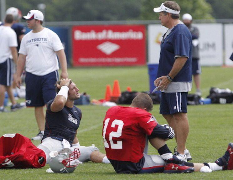 Bill Belichick lords above Tim Tebow and Tom Brady during a 2013 preseason Patriots practice. (Getty Images)