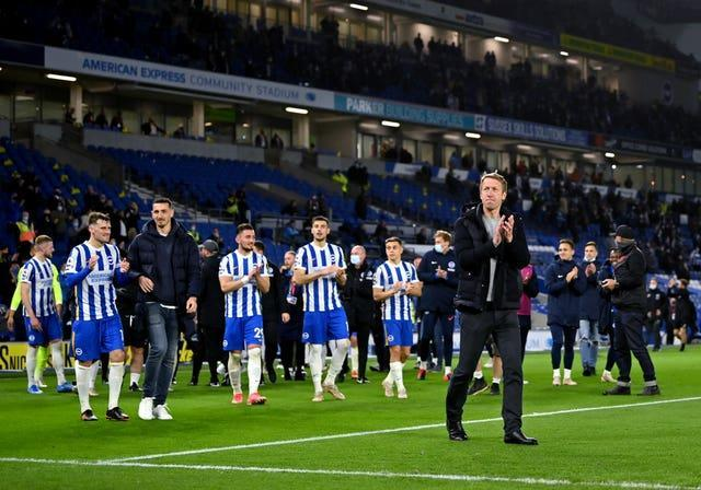 Brighton head coach Graham Potter led his victorious team on a lap of honour at full-time
