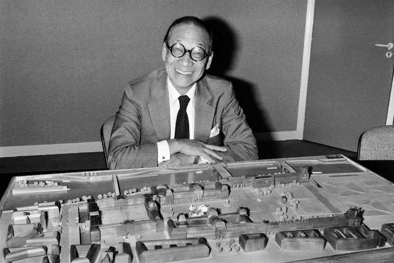 Architect I.M. Pei poses with a model of the Louvre Pyramid in Paris in 1985
