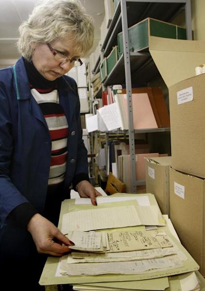 An archivist sorts through old Yiddish and Hebrew manuscripts in Vilnius as part of a project highlighting pre-war Jewish life in Eastern Europe