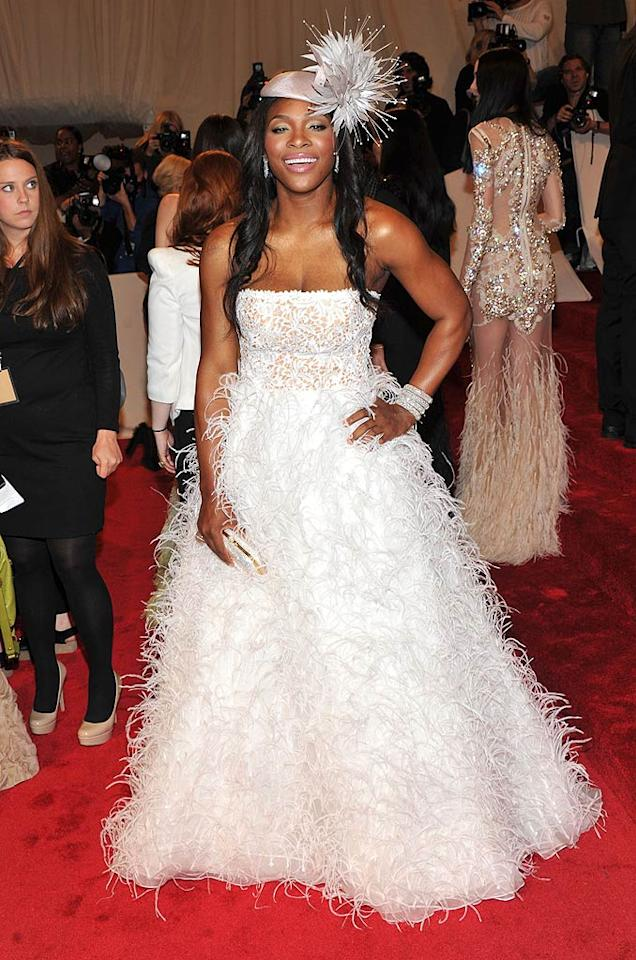 """Tennis ace Serena Williams opted for a feathered Oscar de la Renta frock, stacked bracelets, and royal wedding-inspired chapeau. Stephen Lovekin/<a href=""""http://www.gettyimages.com/"""" target=""""new"""">GettyImages.com</a> - May 2, 2011"""