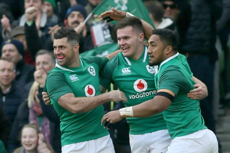 Jacob Stockdale (C) has been given the chance to be the long-term Ireland full-back filling the huge vacuum left by the iconic Rob Kearney (L) who retired from test rugby last month