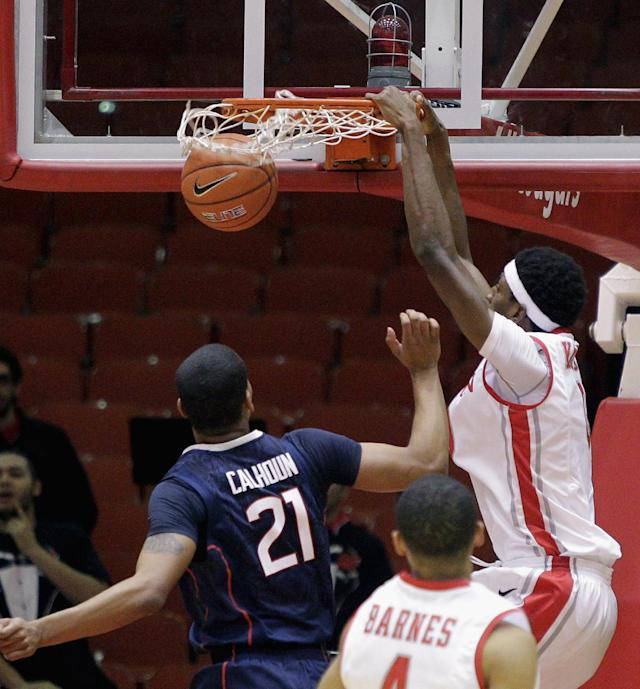 Houston' Danrad Knowles dunks over Connecticut's Omar Calhoun (21) during the first half of an NCAA college basketball game Tuesday, Dec. 31, 2013, in Houston. (AP Photo/Bob Levey)