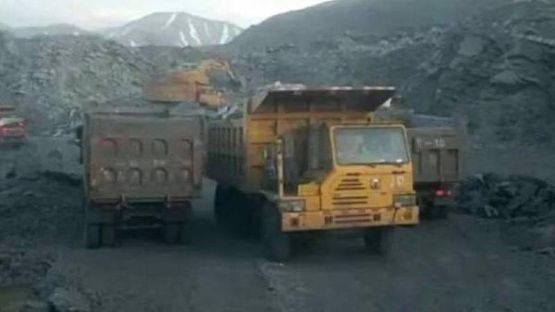 China detains tycoon after media accusations of massive illegal mountain mine