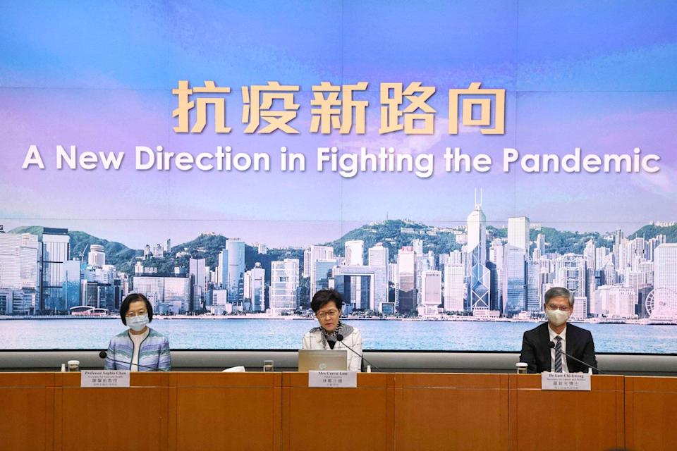 Carrie Lam (centre) outlines a 'new direction' for Hong Kong's pandemic response. Photo: K. Y. Cheng