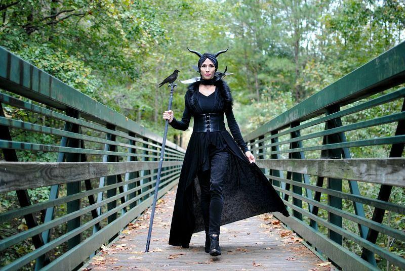 """<p>Who doesn't want to be Maleficent at least one Halloween, especially when you can use store-bought horns and make the staff from a flagpole? We love the addition of the faux raven on top, a nod to shape-shifter Diaval.</p><p><strong>Get the tutorial at <a href=""""http://www.trashtocouture.com/2018/10/diy-halloween-2018-maleficent-and-grinch.html"""" rel=""""nofollow noopener"""" target=""""_blank"""" data-ylk=""""slk:Trash to Couture"""" class=""""link rapid-noclick-resp"""">Trash to Couture</a>.</strong></p><p><a class=""""link rapid-noclick-resp"""" href=""""https://www.amazon.com/OULII-Artificial-Black-Halloween-Display/dp/B077YWS98T/ref=sr_1_8?tag=syn-yahoo-20&ascsubtag=%5Bartid%7C10050.g.36674692%5Bsrc%7Cyahoo-us"""" rel=""""nofollow noopener"""" target=""""_blank"""" data-ylk=""""slk:SHOP FAUX RAVENS"""">SHOP FAUX RAVENS</a><br></p>"""