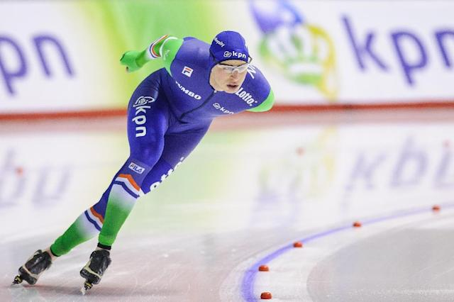 Sven Kramer places first in the men's 5000m during the ISU World Allround Speed Skating Championships on March 7, 2015 in Calgary (AFP Photo/Derek Leung)