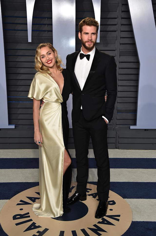 Miley Cyrus and fiancé Liam Hemsworth attend the <em>Vanity Fair</em> — yup, <em>Vanity Fair</em> — Oscar viewing party on March 4, 2018. (Photo: Axelle/Bauer-Griffin/FilmMagic)