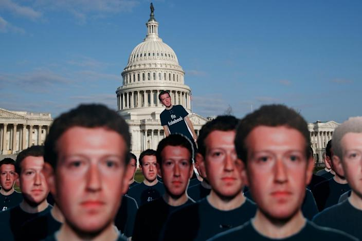 Life-sized cutouts of Facebook CEO Mark Zuckerberg are displayed by an advocacy group on Capitol Hill on April 10, 2018.