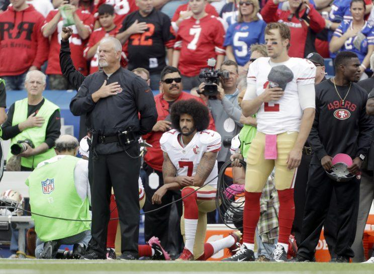 Colin Kaepernick kneels during the National Anthem prior to the 49ers game against Buffalo. (AP)