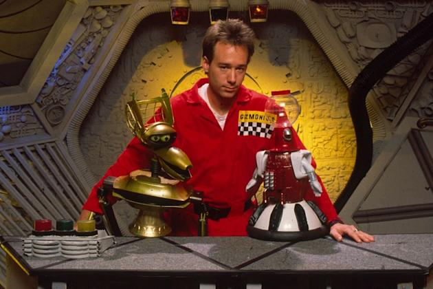 Joel Hodgson with MST 3K robots Crow (left, voiced by Beaulieu) and Tom Servo (voiced by Kevin Wagner Murphy)