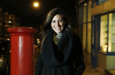 Irish emigrant Ciara Freeman poses for a photograph in her North London neighbourhood November 27, 2013. Almost 500,000 Irish people left the country permanently last year, a near four-fold increase since Ireland's economic crisis began in 2008. Picture taken November 27, 2013. To match story IRELAND-EMIGRATION/ REUTERS/Suzanne Plunkett