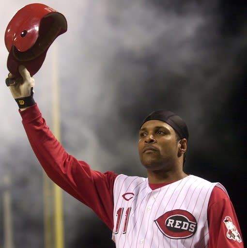 "FILE - In this July 28, 2004, file photo, Cincinnati Reds' Barry Larkin takes a curtain call after hitting a pinch-hit grand slam off St. Louis Cardinals pitcher Steve Kline in the fifth inning of a baseball game in Cincinnati. From the time Larkin collected the 1995 National League Most Valuable Player award, something about the prize bothered him. ""I was made aware that Kenesaw Mountain Landis' name was on it and there was this question: Why is it on there?"" Larkin said this week. (AP Photo/David Kohl, File)"