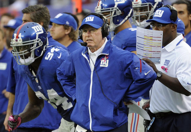 New York Giants head coach Tom Coughlin, center, watches his team play during the first half of an NFL football game against the Philadelphia Eagles, Sunday, Oct. 6, 2013, in East Rutherford, N.J. (AP Photo/Bill Kostroun)