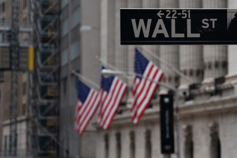 The Wall St sign is picture in front of the New York Stock Exchange (NYSE) in New York City