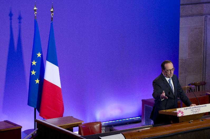 French President Francois Hollande delivers a speech during a social conference with unions and employers on July 7, 2014 at the Economic, Social and Environmental Council of France (CESE) headquarters in Paris