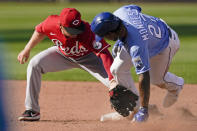 Kansas City Royals' Adalberto Mondesi beats the tag by Cincinnati Reds second baseman Josh VanMeter during the fourth inning of game one of a baseball doubleheader Wednesday, Aug. 19, 2020, in Kansas City, Mo. (AP Photo/Charlie Riedel)
