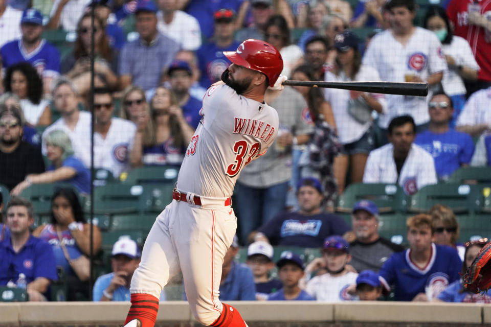 Cincinnati Reds' Jesse Winker watches his home run against the Chicago Cubs during the first inning of a baseball game Tuesday, July 27, 2021, in Chicago. (AP Photo/David Banks)