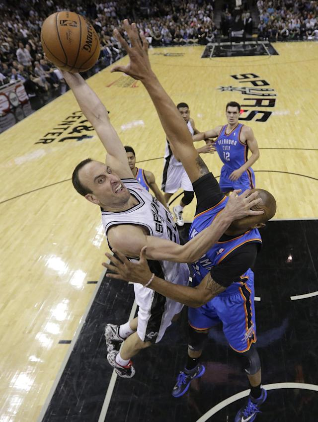 San Antonio Spurs' Manu Ginobili, left, of Argentina, drives to the basket over Oklahoma City Thunder's Caron Butler during the second half of Game 5 of the Western Conference finals NBA basketball playoff series, Thursday, May 29, 2014, in San Antonio. San Antonio won 117-89. (AP Photo/Eric Gay)