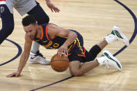 Golden State Warriors guard Stephen Curry dribbles after falling down during the first half of the team's NBA basketball game against the Washington Wizards in San Francisco, Friday, April 9, 2021. (AP Photo/Jed Jacobsohn)