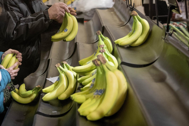 FILE - This Thursday, March 19, 2020 file photo shows bananas on the shelves of a supermarket in North Providence, R.I. On Friday, March 20, 2020, The Associated Press reported on a video circulating online incorrectly asserting that research by scientists at the University of Queensland in Australia has proven that bananas bolster the immune system due to the super source of vitamin B6 and helps prevent coronavirus. A spokesperson for the university told the AP in an email that the video is fake and said they strongly recommend people do not share it. While bananas are a good source of nutrients, including vitamin B6, fiber and potassium, there is no evidence that bananas can prevent or kill coronavirus. (AP Photo/David Goldman)