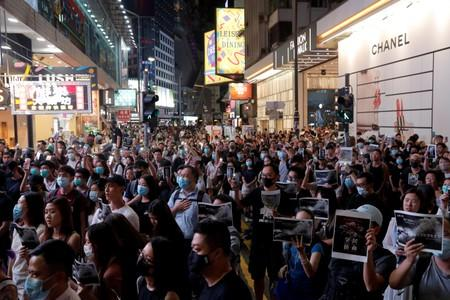 FILE PHOTO: People attend a march in Causeway Bay in solidarity with the student protester who got shot by police with live ammunition in Hong Kong