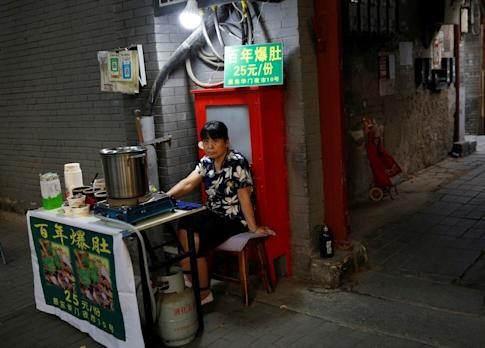 """Many people in China have had to embrace """"flexible employment"""" options such as street vending and delivery work to make ends meet during the pandemic. Photo: Reuters"""