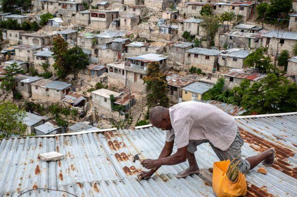 PHOTO: A man secures the roof of his house in response to Tropical Storm Elsa, in Port-au-Prince, Haiti, July 3, 2021. (Joseph Odelyn/AP)