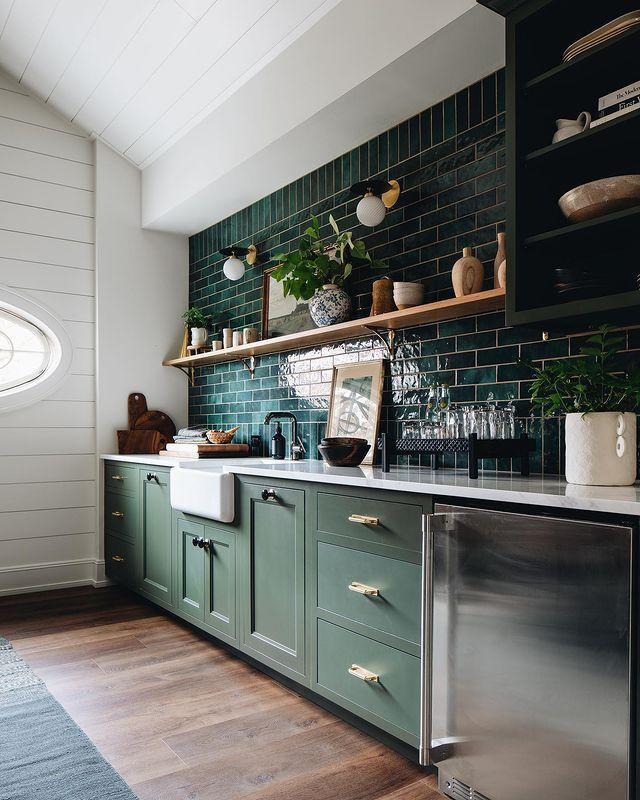 """<p>With glossy forest tile and racing-car green cabinets, this kitchen gives off a moody vibe. </p><p><a href=""""https://www.instagram.com/p/CMh8NZjs4bp/"""" rel=""""nofollow noopener"""" target=""""_blank"""" data-ylk=""""slk:See the original post on Instagram"""" class=""""link rapid-noclick-resp"""">See the original post on Instagram</a></p>"""